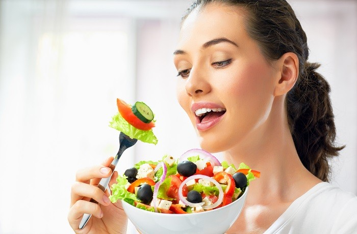 girl-woman-plate-fork-salad-vegetables-charm-cucumbers-olives-onions-cheese-tomatoes